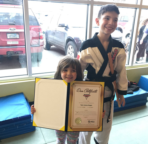 Brother and sister at tae kwon do testing